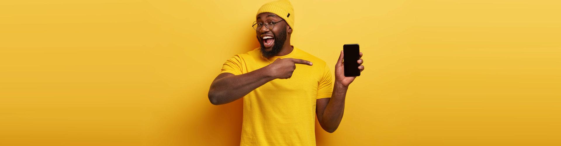 man pointing at his phone
