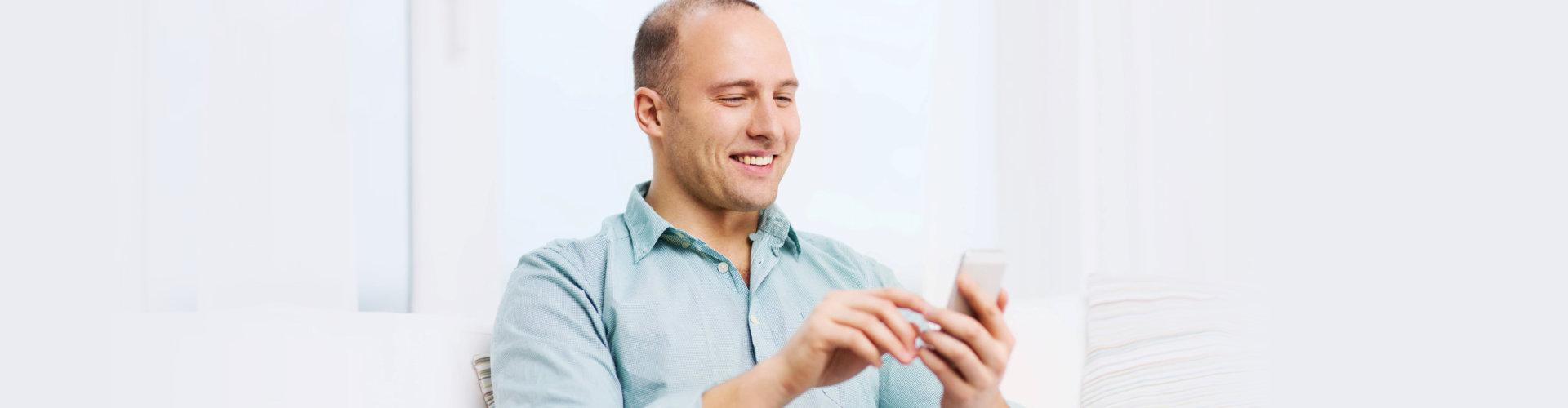 adult man using his phone