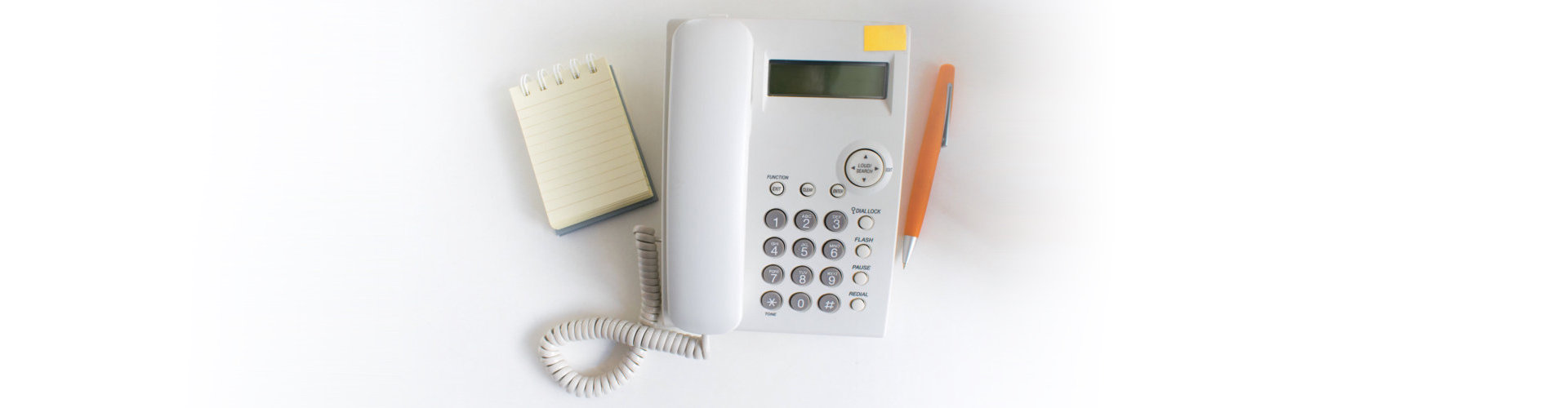 telephone, notebook and a pen
